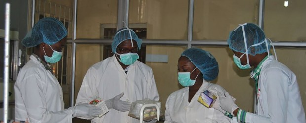Laboratory workers at Paxherbals factory in Nigeria