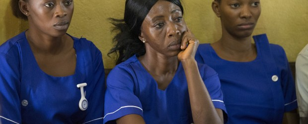 Nurses listen intently during a panel discussion at the United Methodist Church's Mercy Hospital in Bo, Sierra Leone to help prepare health care workers for a possible outbreak of the Ebola virus.