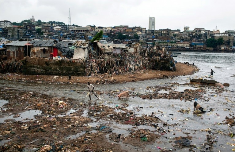 The shore next to Mabella is littered with trash, and untreated sewage flows into the ocean, Freetown, Sierra Leone. Picture by Holly Pickett