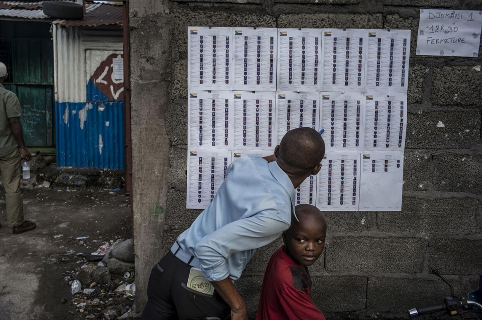 A voter looks at candidates for parliamentary elections in 2015 - Photo credit: Marco Longari / AFP / Getty Images