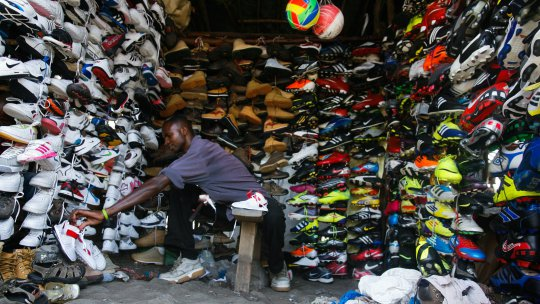 a-kenyan-self-employed-business-man-agustine-karani-arranges-shoes-at-his-shop-in-nairobi